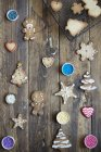 Decorated and unfinished gingerbread cookies on wood — Stock Photo