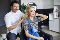Happy woman at the hairdresser — Stock Photo