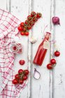 Homemade tomato ketchup and ingredients — Stock Photo
