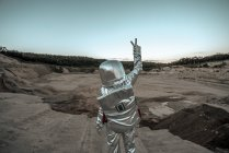 Spaceman making peace sign on nameless planet — Stock Photo