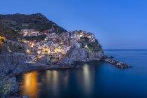 Italy, Liguria, La Spezia, Cinque Terre National Park, Manarola at blue hour — Stock Photo