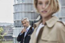 Portrait of  mature businessman walking outdoors — Stock Photo