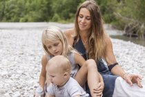 Mother with two children outdoors in the nature — Stock Photo
