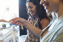 Two young women shopping for new clothes together — Stock Photo