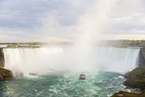Canada, Ontario, Niagara Falls and boat on the river — Stock Photo