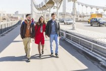 Russia, Moscow, group of friends walking over a bridge — Stock Photo