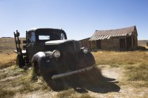 USA, California, Sierra Nevada, Bodie State Historic Park, old wooden house and car — Stock Photo