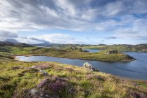 United Kingdom, Scotland, Scottish Highland, Sutherland, Kinlochbervie, Loch Inchard and sunlight — Stock Photo