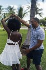 USA, Florida, Miami Beach, happy young couple dancing in a park in summer — Stock Photo