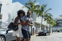 USA, Florida, Miami Beach, happy young couple crossing the street — Stock Photo