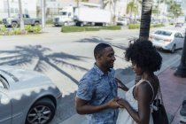 USA, Florida, Miami Beach, smiling affectionate young couple in the city — Stock Photo