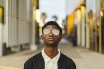Portrait of a young black man wearing glasses — Stock Photo