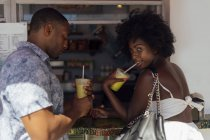 Young couple having a drink at a kiosk — Stock Photo