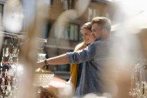 Belgium, Tongeren, happy young couple on an antique flea market — Stock Photo