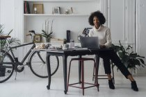 Woman working in her home office, using laptop — Stock Photo