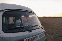 Camper van in rural landscape at sunset — Stock Photo