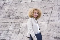 Portrait of fashionable blond woman with with folder — Stock Photo