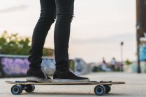 Close-up of young woman riding skateboard — Stock Photo