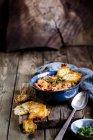 Lasagna soup, deconstructed lasagna served as soup, with parmesan crisps — Stock Photo