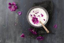 Yogurt with flowers of common mallow and chia seeds, from above — Stock Photo