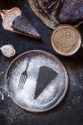 Imprint of a slice of cake and a fork, made with powdered sugar, mug of coffee, chocolate cake — Stock Photo