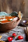 Tomato soup with sour cream and sesame sticks — Stock Photo