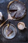 Swedish kladdkaka, dark chocolate cake, swedish brownie, with coffee, close-up — Stock Photo