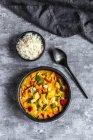 Curry dish, sweet potato curry, sugar pea, paprika, zucchini, coconut milk, shrimps and rice — Stock Photo