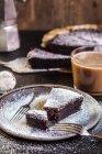 Swedish kladdkaka, dark chocolate cake, swedish brownie with coffee — Stock Photo