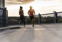 Young couple jogging in the morning — Stock Photo