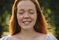 Portrait of redheaded girl with closed eyes — Stock Photo