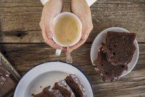 Homemade chocolate cake and cup of coffee on wood — Stock Photo