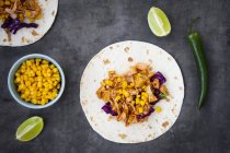Wraps with marinated jackfruit, maize, red cabbage, coriander, lime and chili — Stock Photo