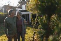 Affectionate senior couple embracing in garden — Stock Photo