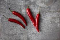 Червоний перець чилі на сірий фон — стокове фото