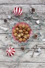 Walnuts on a plate with Christmas decoration, overhead view — Stock Photo