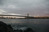 USA, New York, New York City, View to Brooklyn and Manhattan Bridge in the morning light — Stock Photo