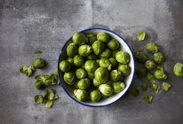Bowl of organic Brussels Sprouts — Stock Photo