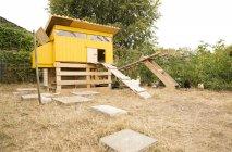 Chicken house in garden at daytime — Stock Photo