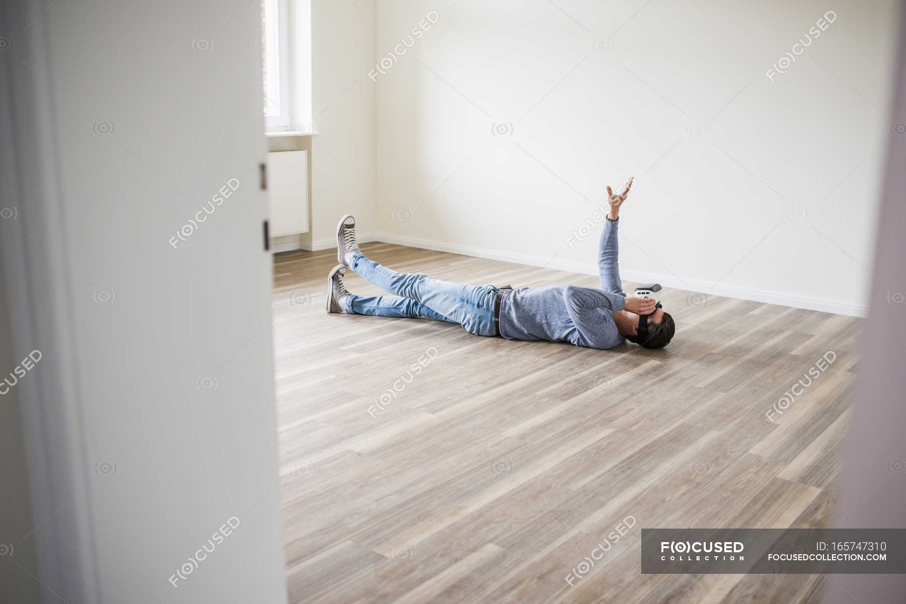 Man lying on the floor in empty