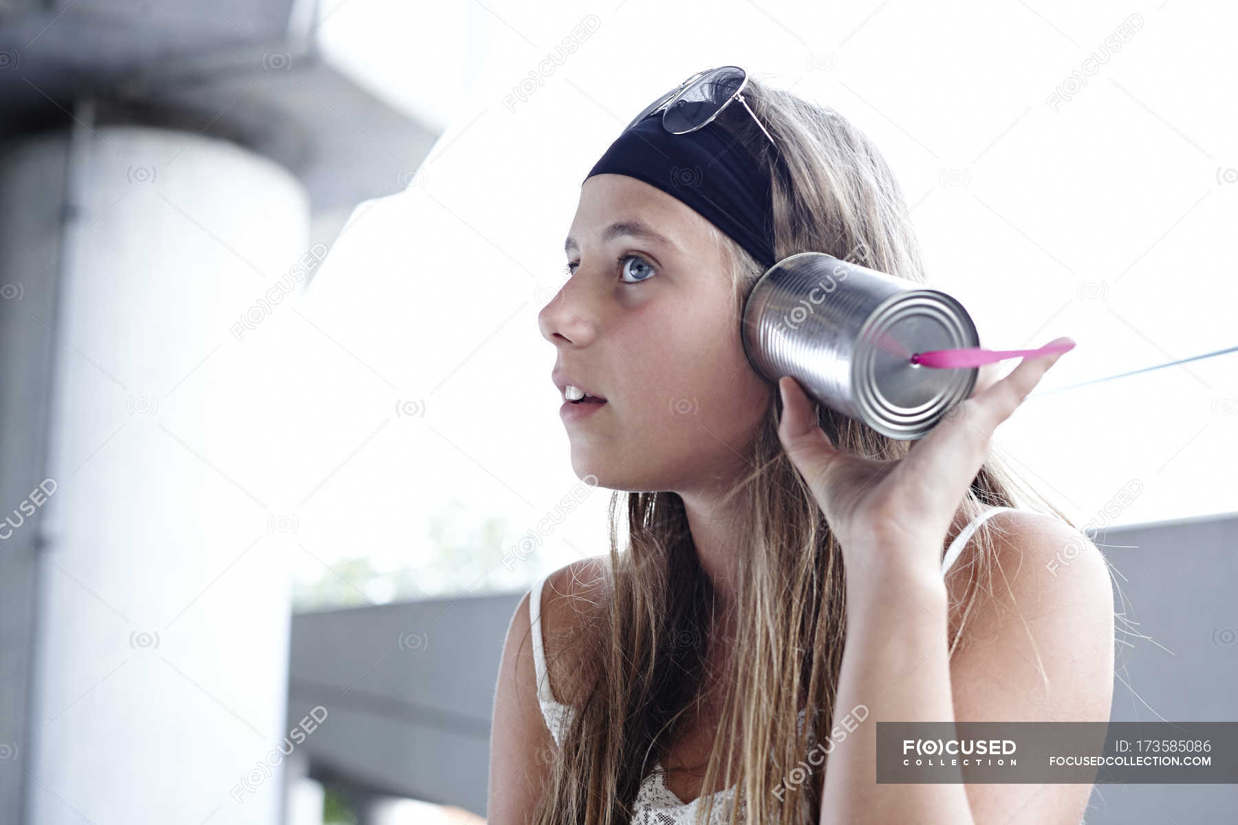 Girl Listening At Tin Can Phone Using Retro Style Stock Photo 173585086