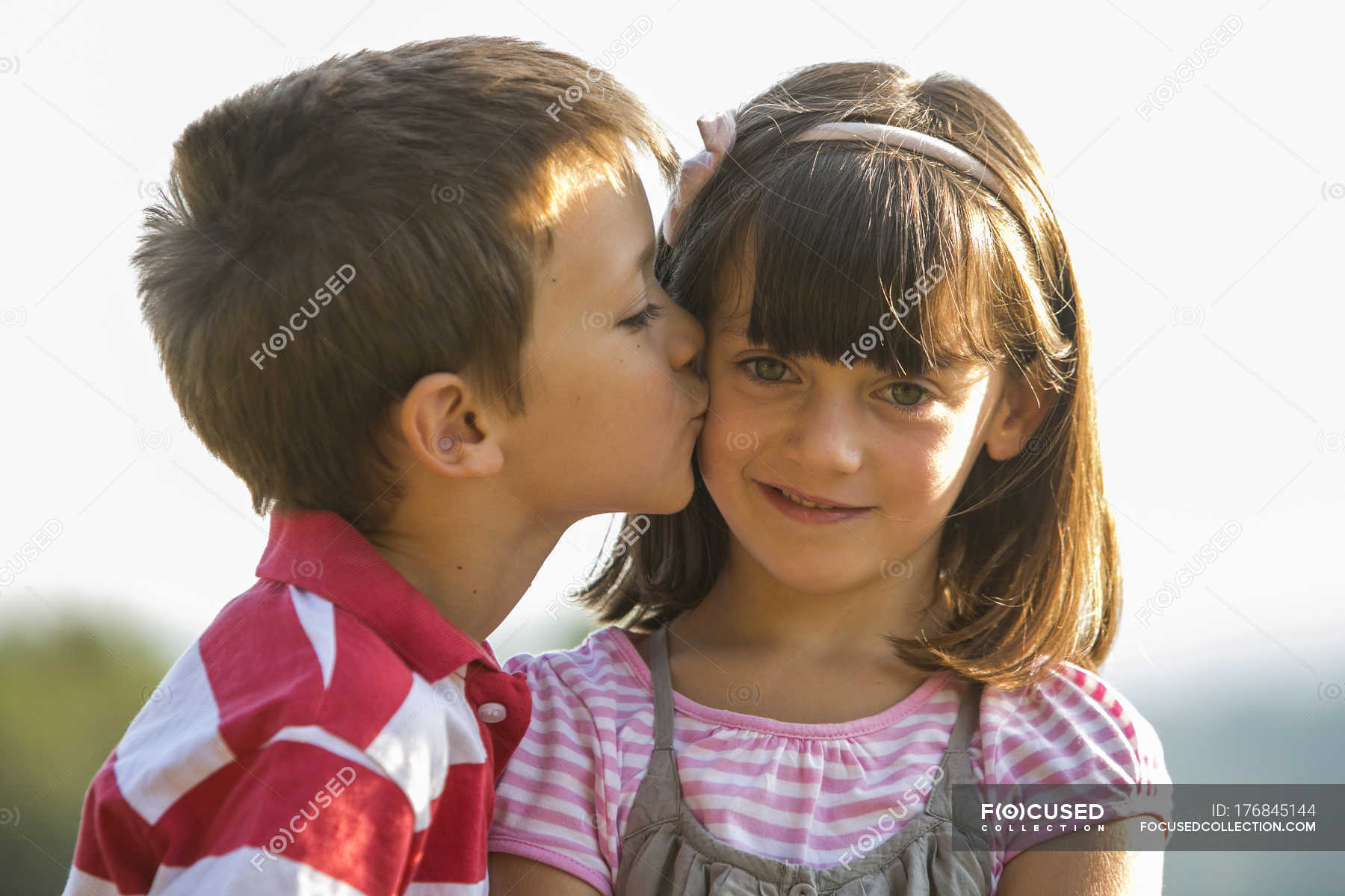 Little boy kissing smiling girl stock photo 176845144 altavistaventures Images