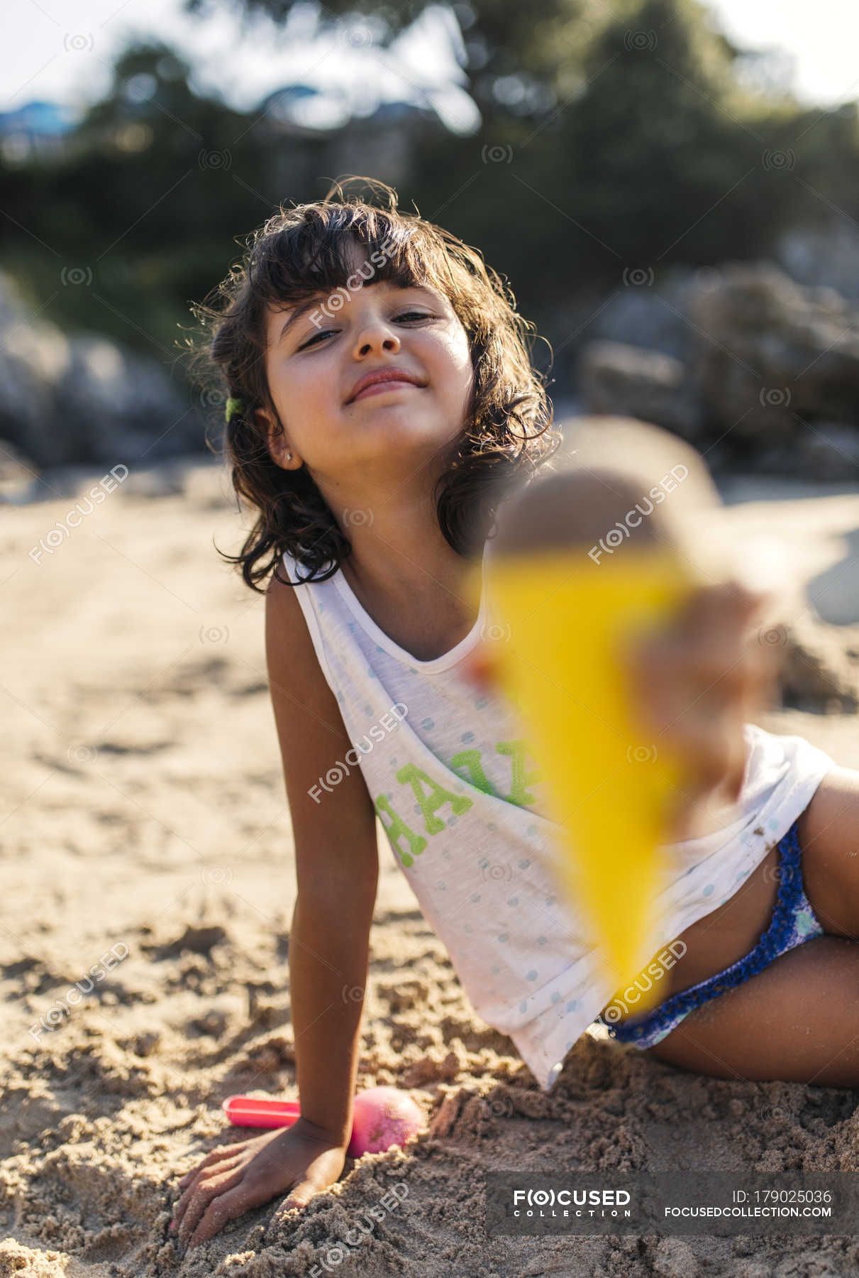 Young Girl Having Fun Building Sand Castle On Beach Stock