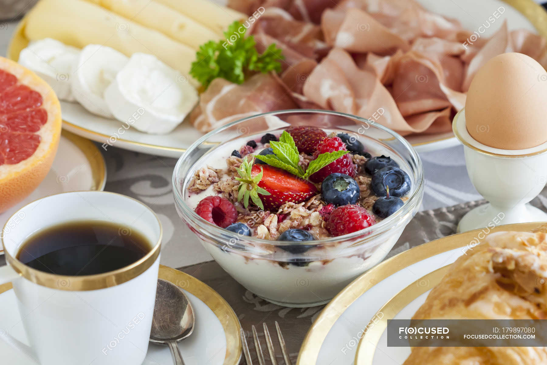 Healthy Breakfast On Table With Bowls And Plates Dishes Fruit Stock Photo 179897080