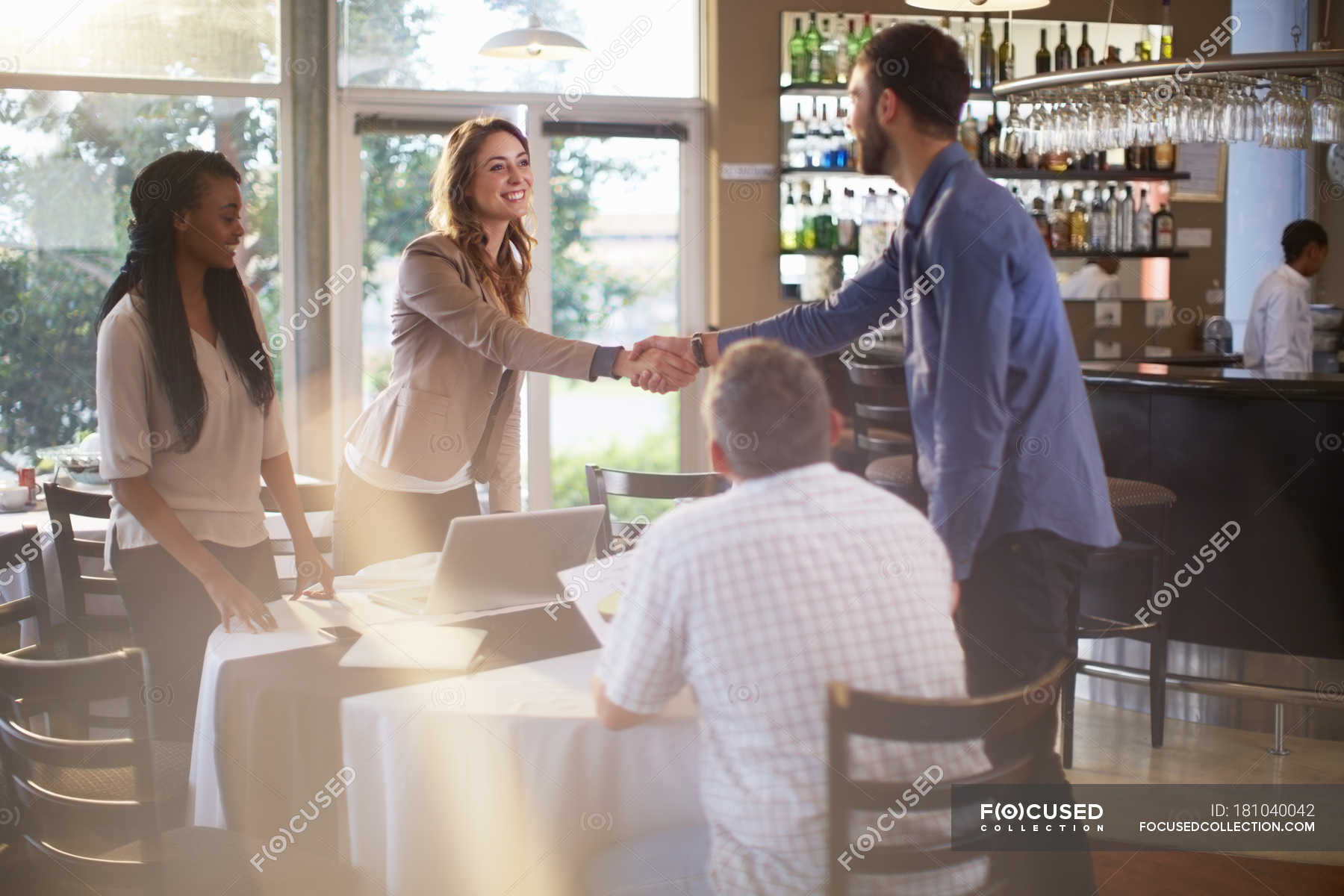 People Greeting Each Other At A Business Meeting In A Restaurant