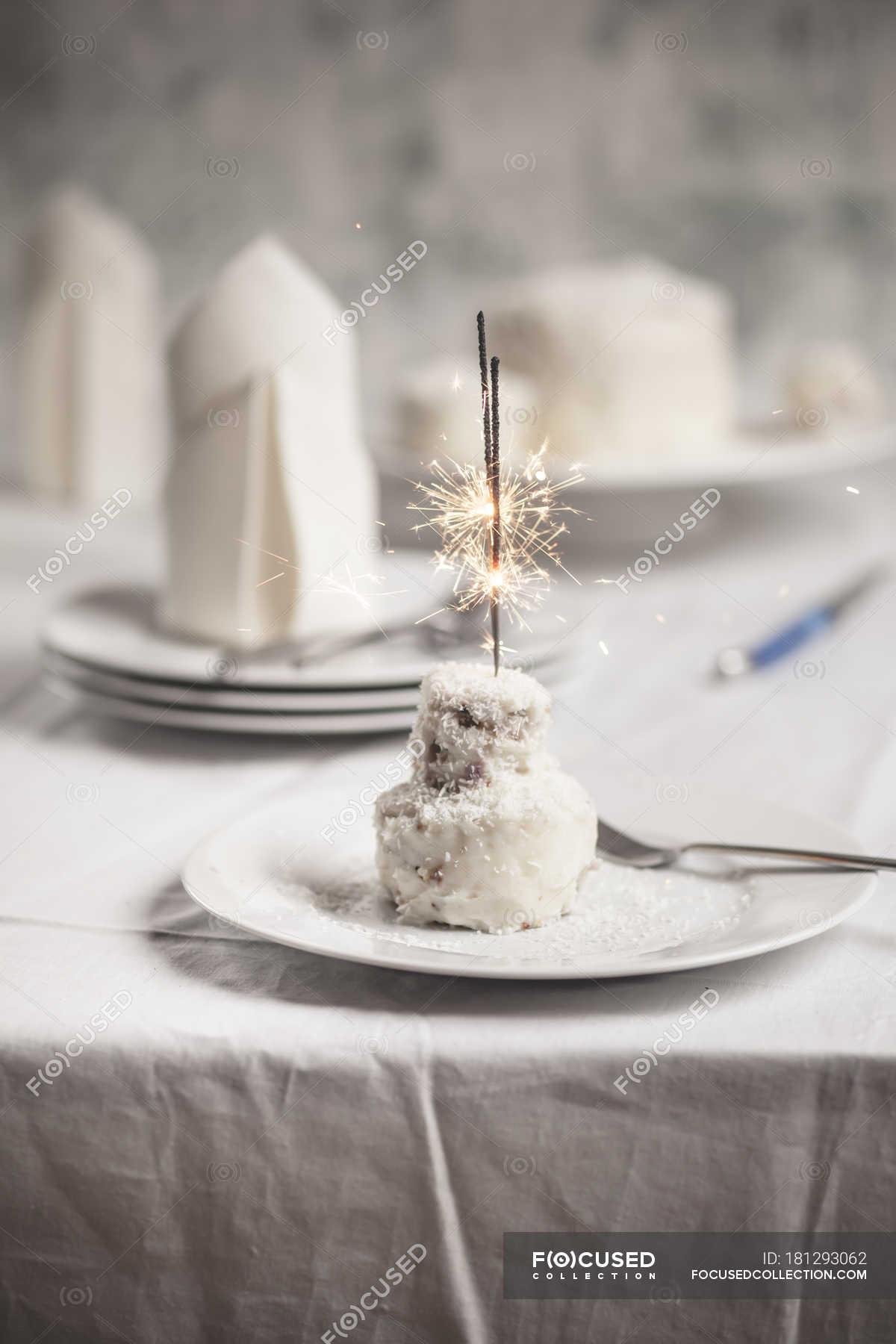 Sensational Mini Coconut Birthday Cake With Sparklers On Plate Knife Fancy Funny Birthday Cards Online Inifodamsfinfo
