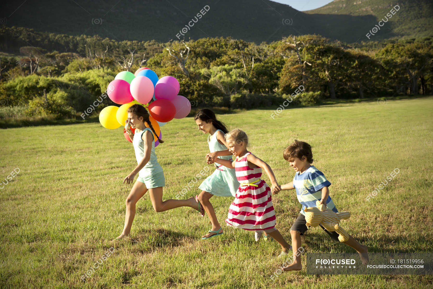 https://st.focusedcollection.com/14026668/i/1800/focused_181519956-stock-photo-happy-children-running-balloons-meadow.jpg