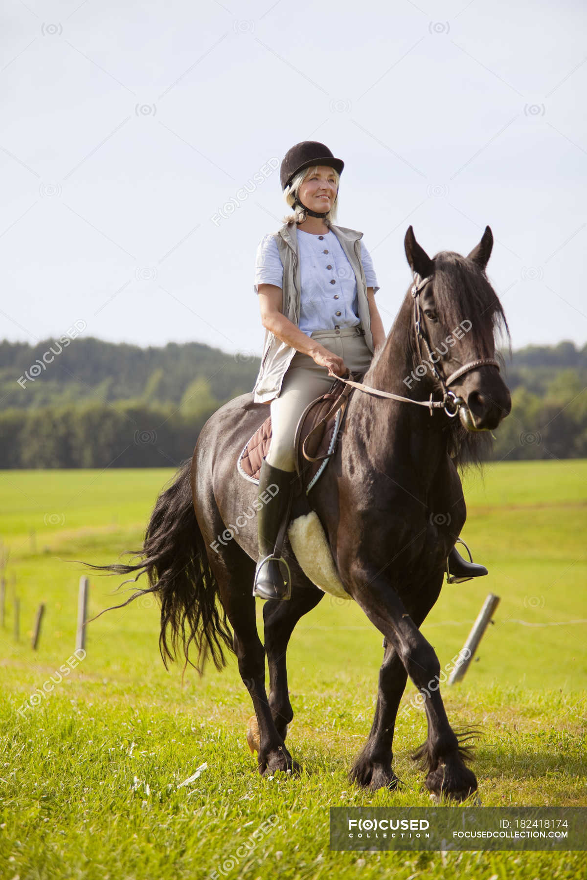 mature woman riding horse — stock photo | #182418174