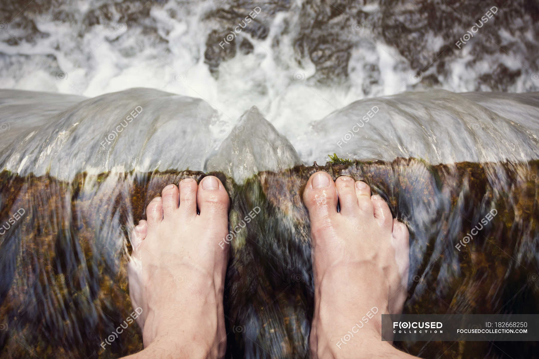 Barefooted Man Standing At Edge Of