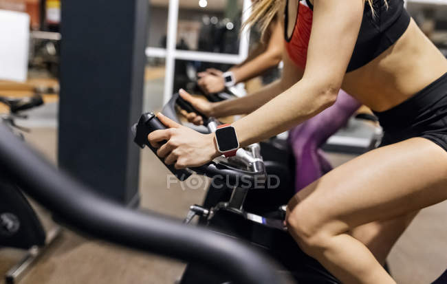 Woman on spinning bike — Stock Photo